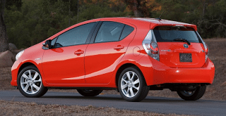 2012 Toyota Prius C red rear three quarter angle