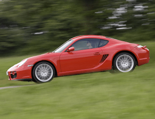 2007 Porsche Cayman side angle red