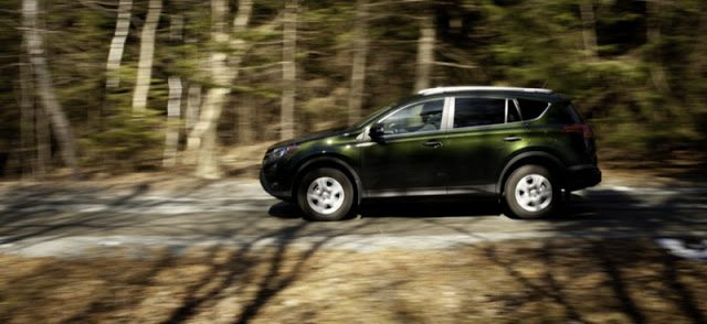 2013 Toyota RAV4 LE in motion side angle