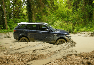 2013 Land Rover Range Rover Sport in mud