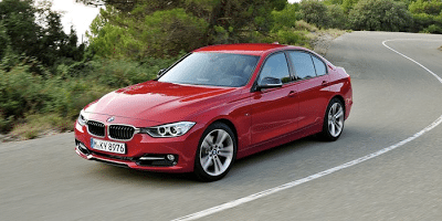 2012 BMW 3-Series red cornering