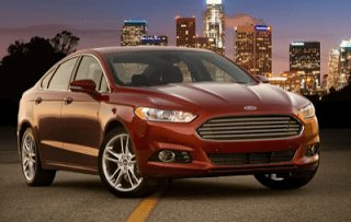 2013 Ford Fusion red city scape