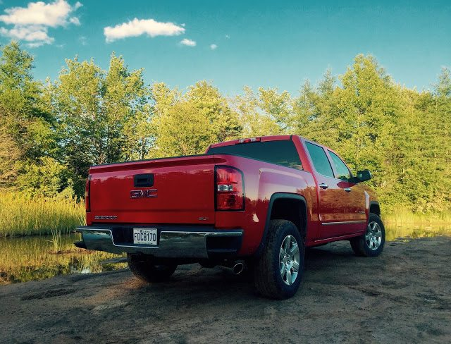 2015 GMC Sierra red crew cab rear