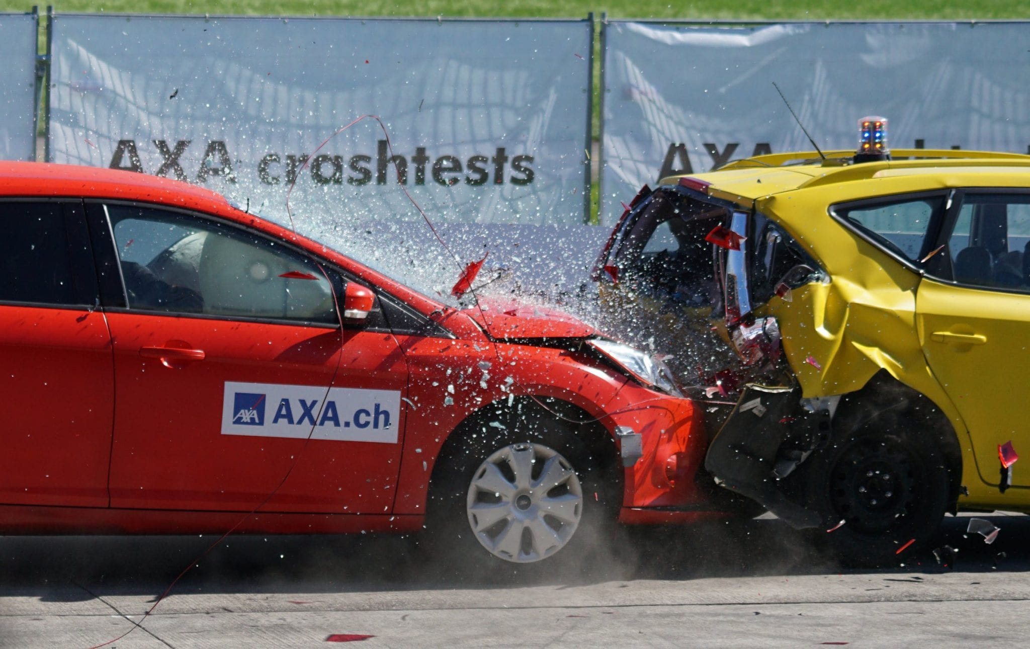 Red car crashing into the back of a yellow car