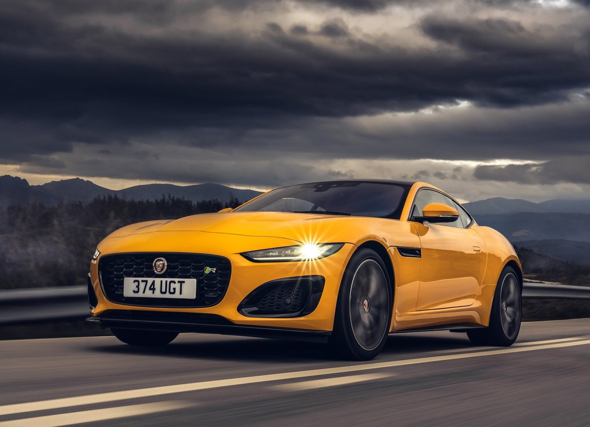 A view of a Yellow 2021 Jaguar F-Type R Convertible