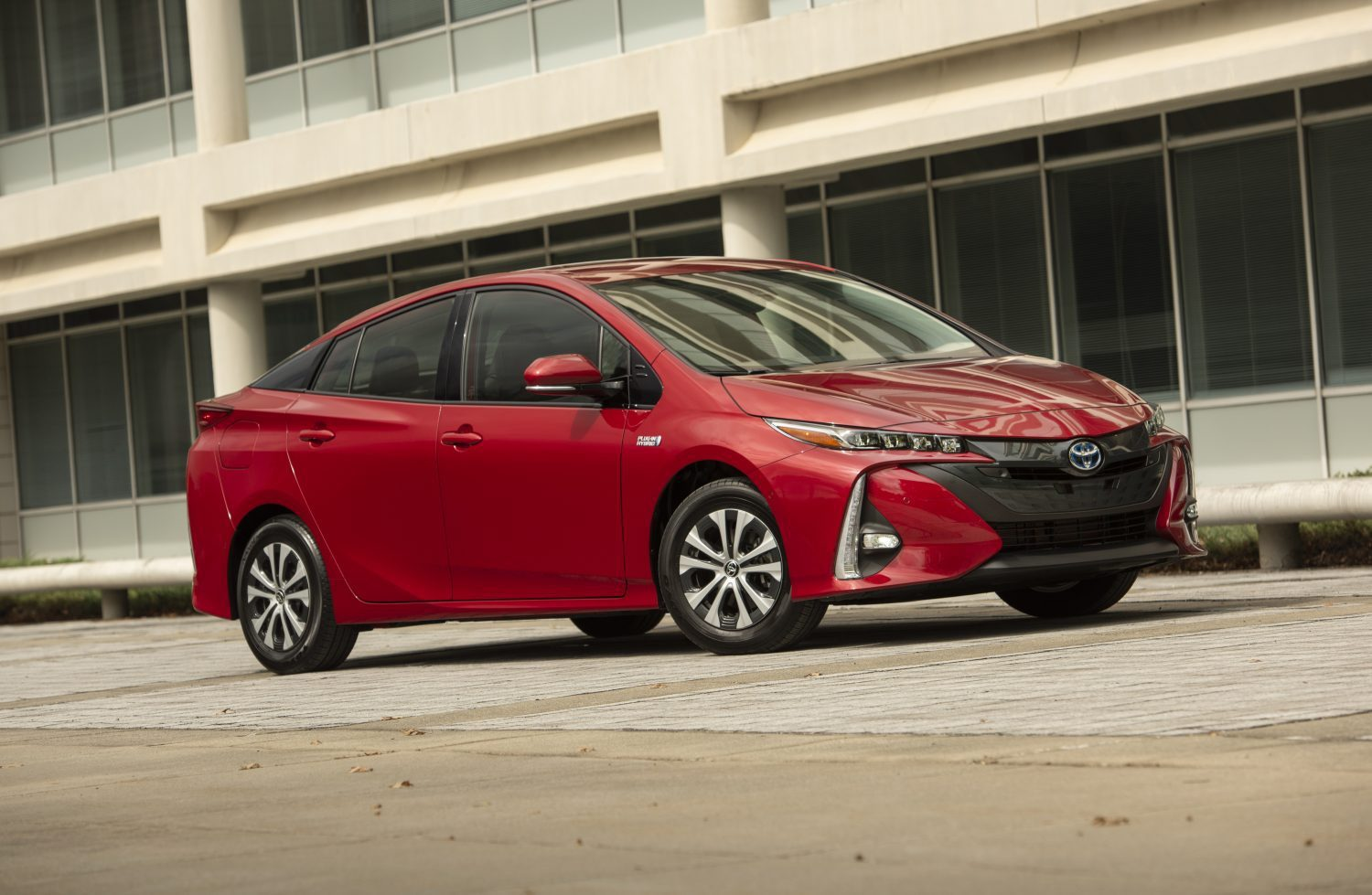 A view of a 2021 Red Toyota Prius Sedan