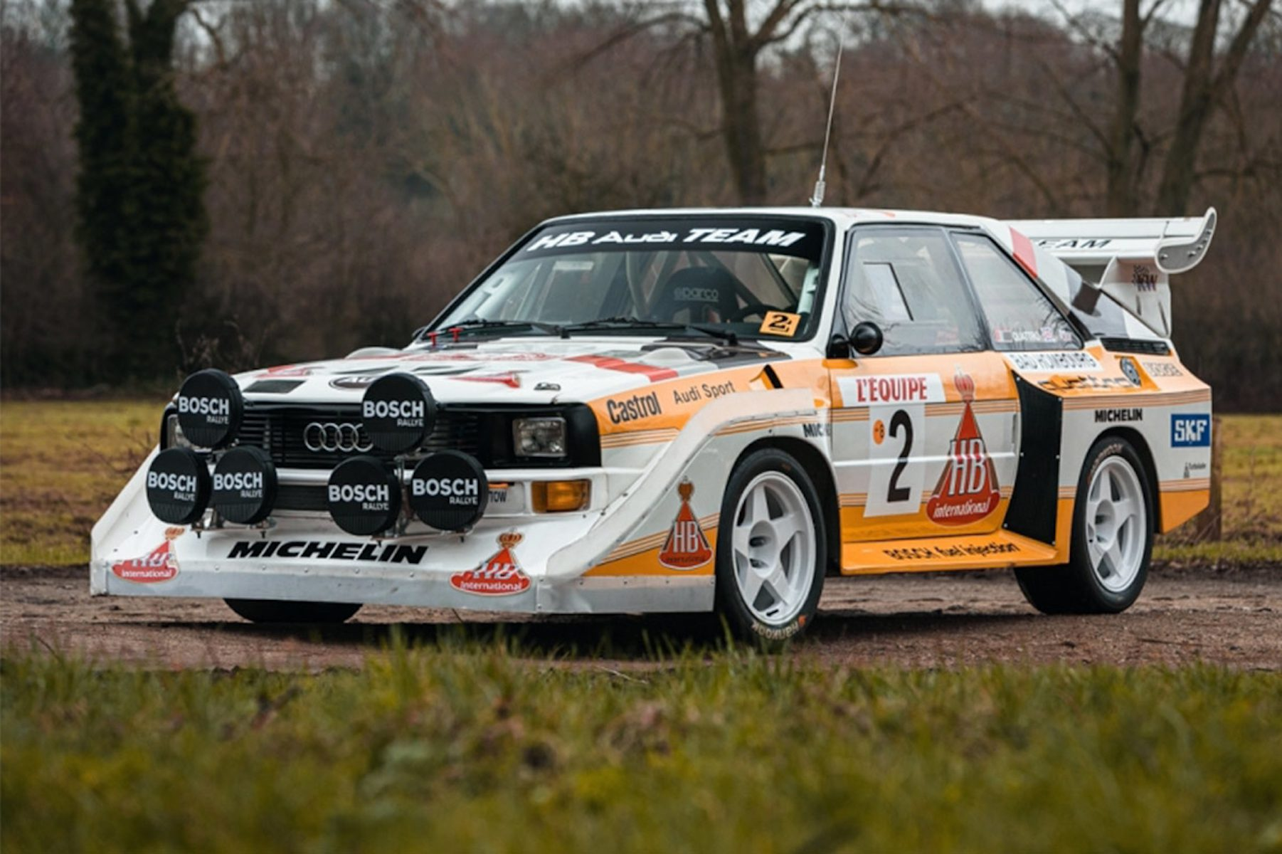 A side view of a 1986 Audi Sport Quattro S1 Evo 2 Rally Car in its natural habitat.