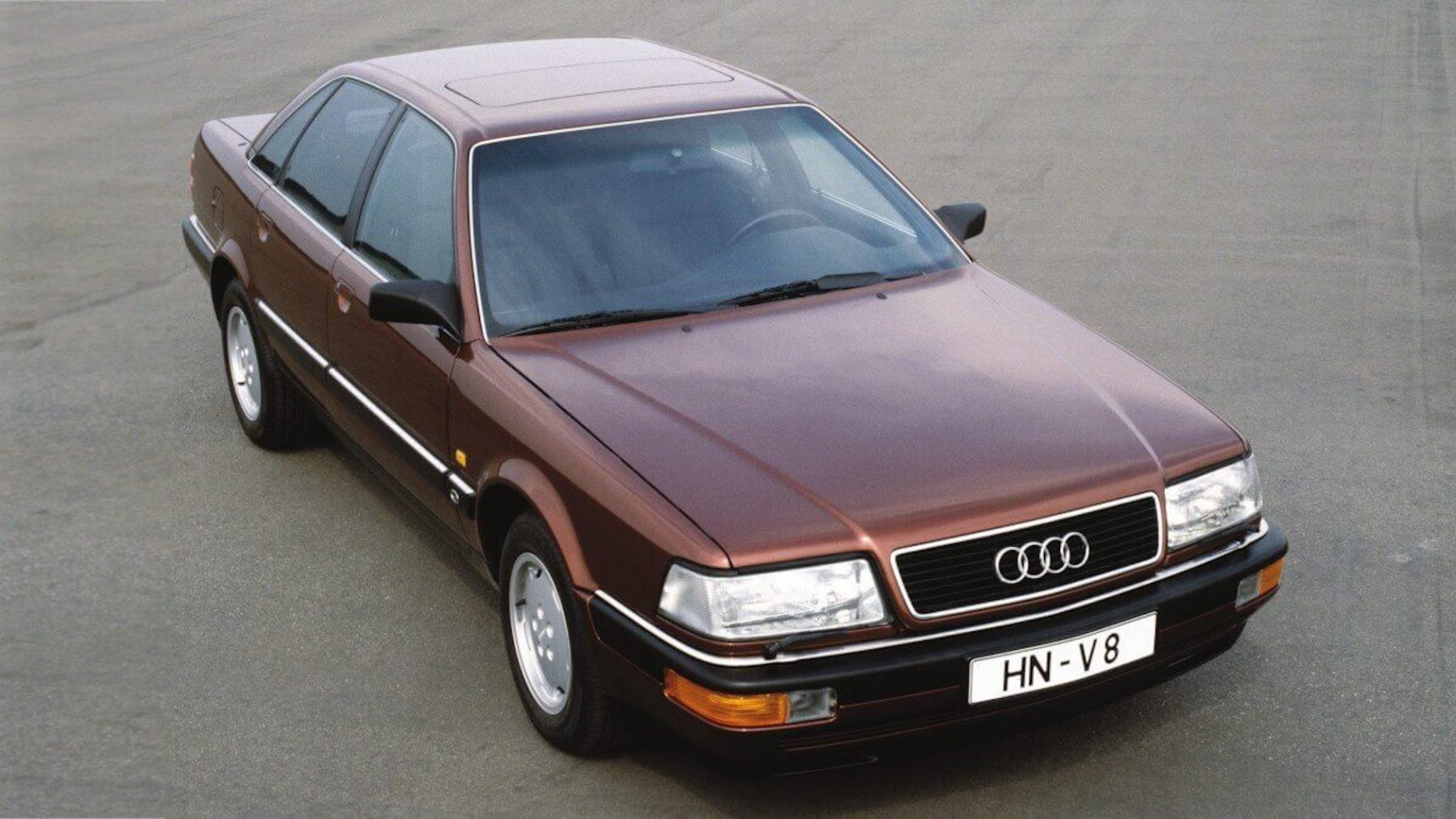 A side view of a brown 1988 Audi V8 Sedan in a parking lot