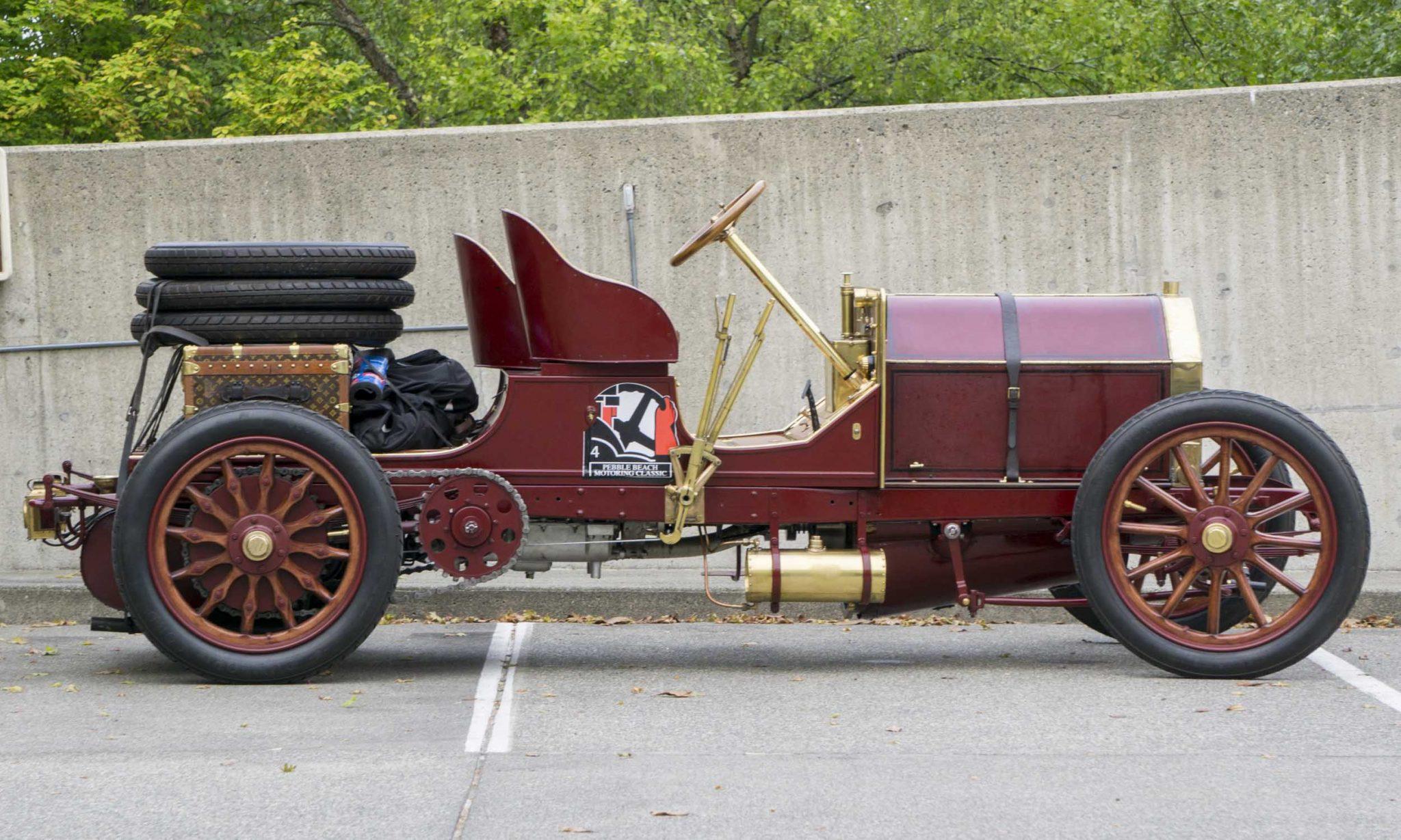Dark red 1904 Fiat 60hp sitting in parking lot